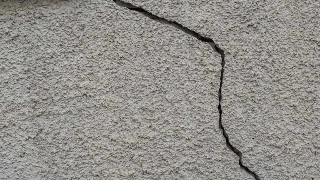a building with a cracked drywall shows common construction defects