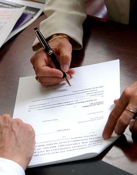 Breaking a Contract lawyer is reviewing options with clients