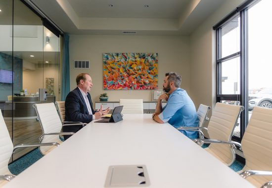 insurance defense attorney jeff aultman meets with client